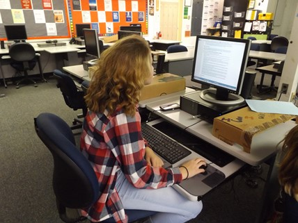 Student working on the a desktop computer