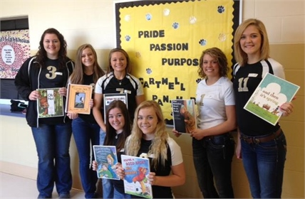 Panther Volleyball players read to Cartmell students.